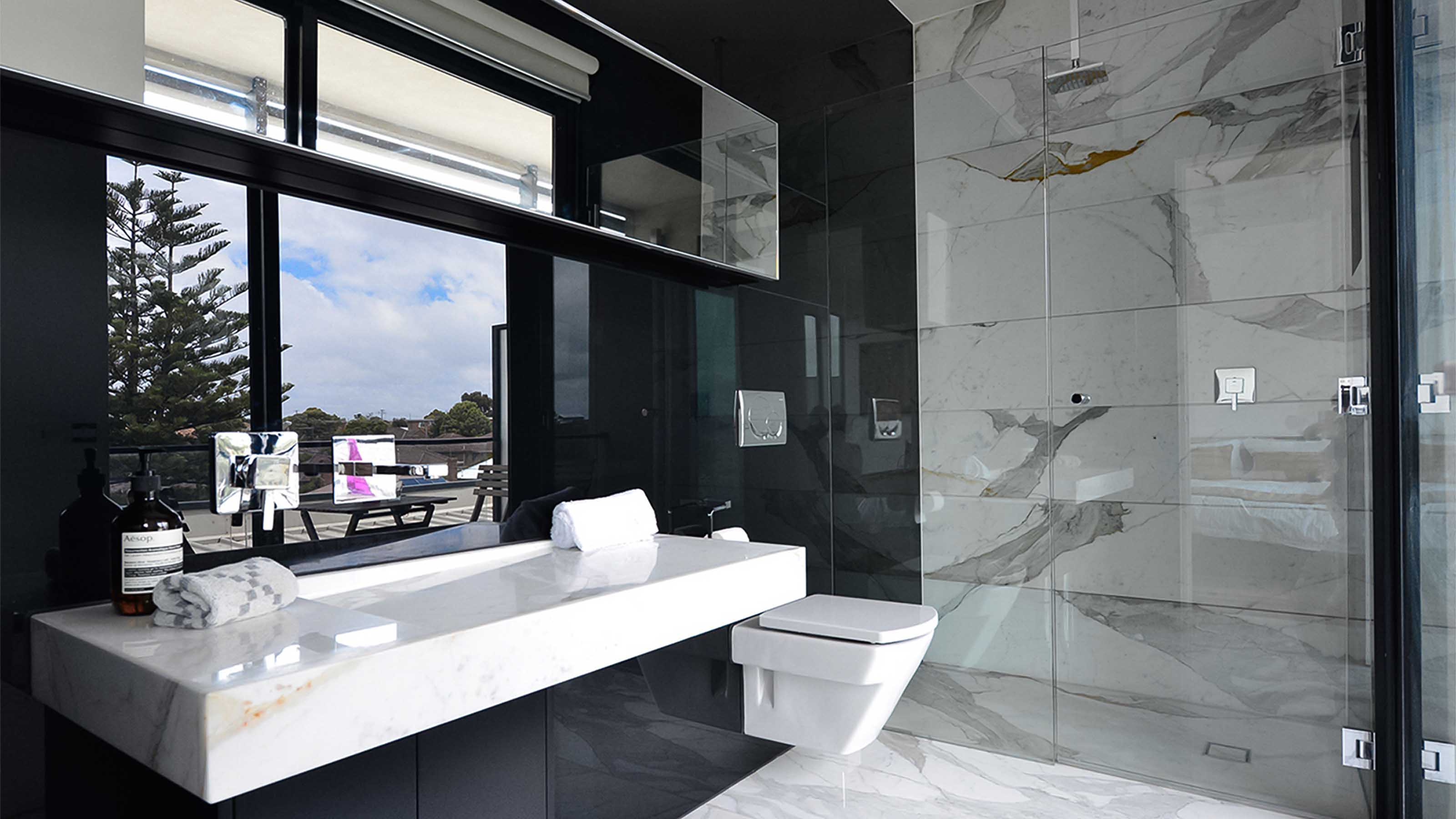 Glass splashbacks for bathroom sinks - Kolor Atmos Reflect Black Glass Splashbacks Frameless Shower Screen